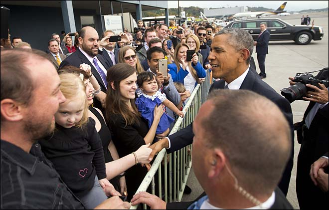 President Barack Obama greets guests on the tarmac following his arrival at King County International Airport in Seattle, Friday, Oct. 9, 2015. Obama is scheduled to attend a democratic fundraiser event with Sen. Patty Murray, D-Wash. He's is also attending fundraisers in San Francisco and Los Angeles as part of a four-day West Coast tour. (AP Photo/Pablo Martinez Monsivais)