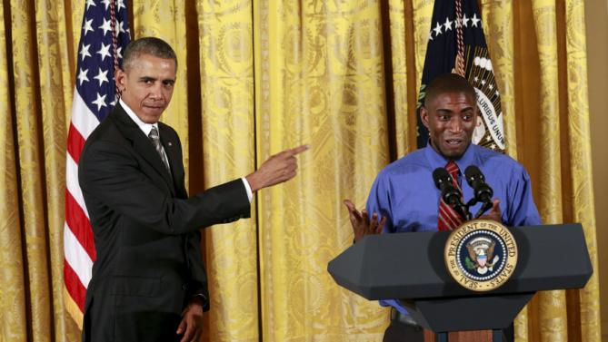 U.S. President Barack Obama is introduced by Terrance Wise, a second-generation fast food worker, at the White House Summit on Worker Voice in Washington October 7, 2015. REUTERS/Kevin Lamarque TPX IMAGES OF THE DAY