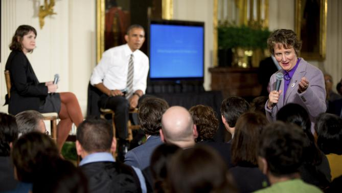President Barack Obama, second from left, and Michelle Miller, co-founder of coworker.org, left, listen as International President of the Service Employees International Union Mary Kay Henry, right, speaks during a conversation co-hosted by Coworker.org at the White House Summit on Worker Voice, Wednesday, Oct. 7, 2015, in the East Room of the White House in Washington. Workers, employers, unions, organizers and other advocates were meeting on how to energize a new generation of Americans to come together and recognize the potential power of their voice at work. (AP Photo/Andrew Harnik)