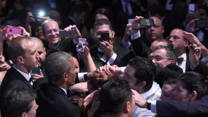 President Barack Obama greets the crowd after speaking at the Congressional Hispanic Caucus Institute's (CHCI) 38th Anniversary Awards Gala in Washington, Thursday, Oct. 8, 2015. The Awards Gala is the signature event in its Hispanic Heritage Month list of events that include the Public Policy Conference. (AP Photo/Susan Walsh)