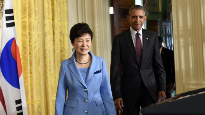 President Barack Obama and South Korean President Park Geun-hye arrive for their joint news conference in the East Room of the White House in Washington, Friday, Oct. 16, 2015. (AP Photo/Susan Walsh)