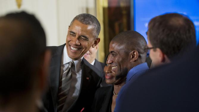 President Barack Obama stops to pose for a photograph with Terrence Wise, right, and Wise's mom Joann Wise, center, during the White House Summit on Worker Voice, Wednesday, Oct. 7, 2015, in the East Room of the White House in Washington. The summit is an effort to give unions, organizers and some businesses a platform to discuss wages and other issues. Terrence Wise is a second-generation fast food worker from Kansas City, Mo. (AP Photo/Pablo Martinez Monsivais)
