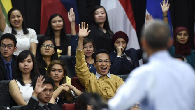People raise their hand in hopes of asking President Barack Obama a question as he speaks at the Young Southeast Asian Leaders Initiative (YSEALI) town hall at Taylor's University in Kuala Lumpur, Malaysia, Friday, Nov. 20, 2015. (AP Photo/Susan Walsh)