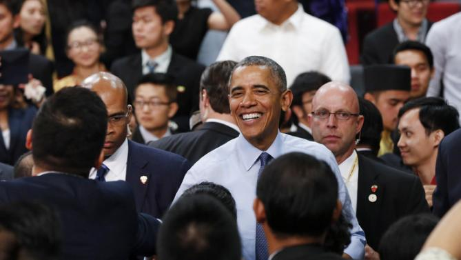 "U.S. President Barack Obama smiles as he finishes the Young Southeast Asian Leaders Initiative (YSEALI) town hall meeting at Taylor's University in Kuala Lumpur, Malaysia, Friday, Nov. 20, 2015. Obama urged young people in predominantly Muslim Malaysia on Friday to reject the ""terrible vision"" that drove the Paris attacks, offering an alternative vision in which traditional cultures coexist with a diverse modern world. (AP Photo/Vincent Thian)"