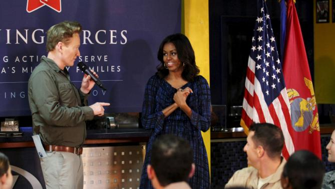 U.S. first lady Michelle Obama (R) is introduced to speak to U.S troops stationed at Al Udeid air base west of Doha, Qatar November 3, 2015. REUTERS/Naseem Zeitoon