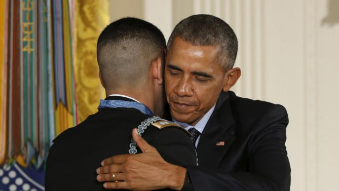 U.S. President Barack Obama hugs retired U.S. Army Captain Florent Groberg, 32, after presenting him with the Medal of Honor during a ceremony at the White House in Washington, DC November 12, 2015. Groberg was badly wounded thwarting a suicide bomber in Afghanistan on what he has called the worst day of his life. REUTERS/Kevin Lamarque