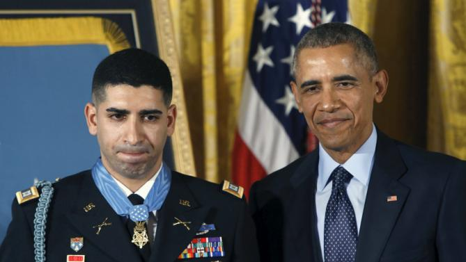 """U.S. President Barack Obama stands with Medal of Honor recipient retired U.S. Army Captain Florent """"Flo"""" Groberg (L) in the East Room of the White House in Washington November 12, 2015. Groberg received the Medal of Honor for his courageous actions while serving as a personal security detachment commander during combat operations in Kunar Province, Afghanistan on August 8, 2012. REUTERS/Gary Cameron"""