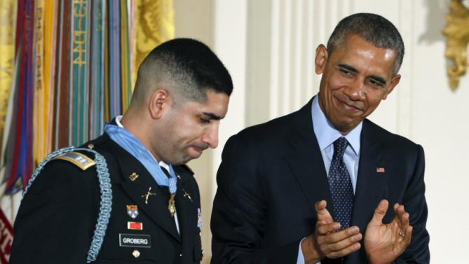 U.S. President Barack Obama applauds retired U.S. Army Captain Florent Groberg, 32, after presenting him with the Medal of Honor during a ceremony at the White House in Washington, DC November 12, 2015. Groberg received the Medal of Honor for his courageous actions while serving as a personal security detachment commander during combat operations in Kunar Province, Afghanistan on August 8, 2012. REUTERS/Kevin Lamarque