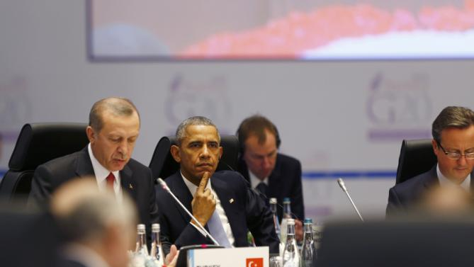 Turkey's President Tayyip Erdogan (L) British Prime Minister David Cameron (R) U.S. President Barack Obama attend a working session at the Group of 20 (G20) summit in the Mediterranean resort city of Antalya, Turkey, November 15, 2015. REUTERS/Murad Sezer