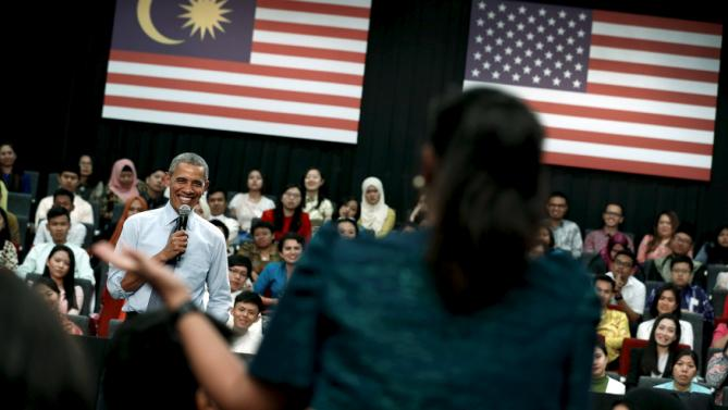 U.S. President Barack Obama takes a question as he participates in a town hall meeting with Young Southeast Asian Leaders Initiative (YSEALI) attendees at Taylor's University in Kuala Lumpur, Malaysia November 20, 2015, before attending the ASEAN summit meeting. REUTERS/Jonathan Ernst