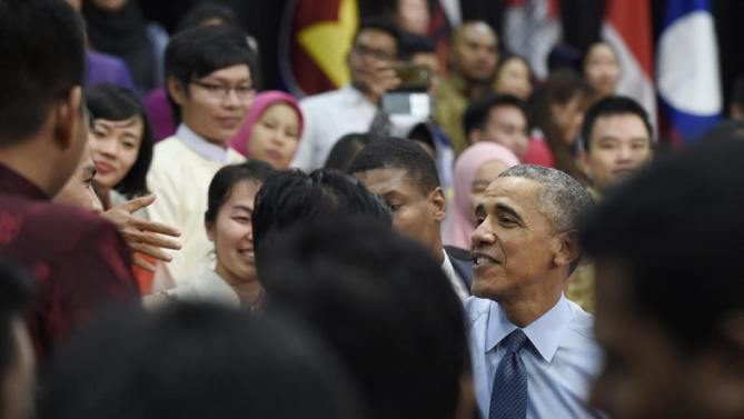 President Barack Obama shakes hands with audience members after speaking at the Young Southeast Asian Leaders Initiative (YSEALI) town hall at Taylor's University in Kuala Lumpur, Malaysia, Friday, Nov. 20, 2015. (AP Photo/Susan Walsh)