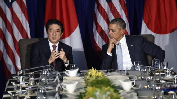 U.S. President Barack Obama, right, listens as Japan's Prime Minister Shinzo Abe, left, talks during a bilateral meeting at the Asia-Pacific Economic Cooperation summit in Manila, Philippines, Thursday, Nov. 19, 2015. (AP Photo/Susan Walsh)