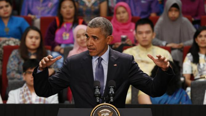 "U.S. President Barack Obama speaks at the Young Southeast Asian Leaders Initiative (YSEALI) during a town hall meeting at Taylor's University in Kuala Lumpur, Malaysia, Friday, Nov. 20, 2015. President Obama urged young people in predominantly Muslim Malaysia on Friday to reject the ""terrible vision"" that drove the Paris attacks, offering an alternative vision in which traditional cultures coexist with a diverse modern world. (AP Photo/Vincent Thian)"