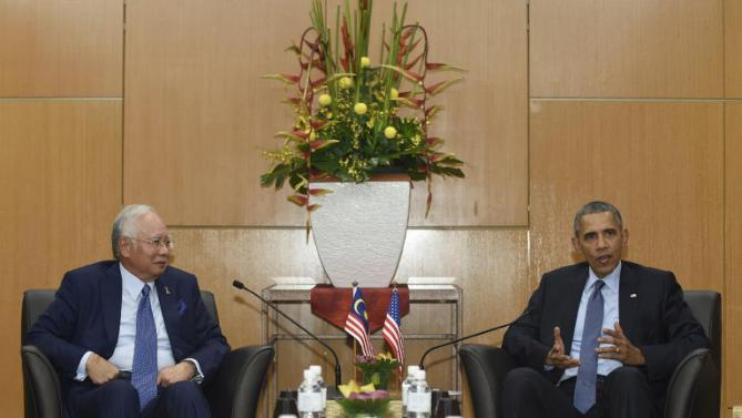 U.S. President Barack Obama, right, speaks as he meets with Malaysia's Prime Minister Najib Razak, left, in Kuala Lumpur, Malaysia, Friday, Nov. 20, 2015. Obama is in Malaysia where he will join leaders from Southeast Asia to discuss trade and economic issues, and terrorism and disputes over the South China Sea. (AP Photo/Susan Walsh)
