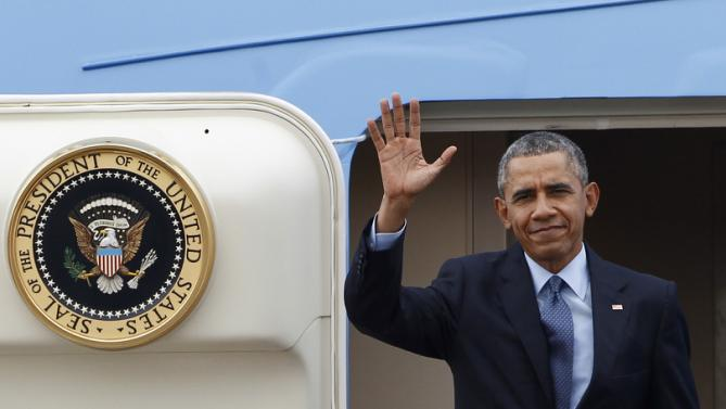 U.S. President Barack Obama waves from the doorway of Air Force One upon arriving at Subang Airbase in Kuala Lumpur, Malaysia, Friday, Nov. 20, 2015. Obama in in Malaysia where he joins leaders from Southeast Asia to discuss trade and economic issues, and terrorism and disputes over the South China Sea. (AP Photo/Joshua Paul)