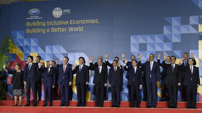 President Barack Obama, third right in front, poses for a family photo with other leaders at the Asia-Pacific Economic Cooperation summit in Manila, Philippines, Thursday, Nov. 19, 2015. Leaders in front row are, from left, Chile's President Michelle Bachelet, Canadian Prime Minister Justin Trudeau, Brunei's Sultan Hassanal Bolkiah, Australia's Prime Minister Malcolm Turnbull, Chinese President Xi Jinping, Philippines President Benigno Aquino III, Mexico's President Enrique Pena Nieto, Vietnam's President Truong Tan Sang, Obama, Thai Prime Minister Prayuth Chan-ocha and Taiwan's envoy Vincent Siew. (AP Photo/Susan Walsh)