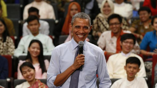 "U.S. President Barack Obama smiles as he takes questions from the floor at the Young Southeast Asian Leaders Initiative (YSEALI) town hall meeting at Taylor's University in Kuala Lumpur, Malaysia, Friday, Nov. 20, 2015. Obama urged young people in predominantly Muslim Malaysia on Friday to reject the ""terrible vision"" that drove the Paris attacks, offering an alternative vision in which traditional cultures coexist with a diverse modern world. (AP Photo/Vincent Thian)"