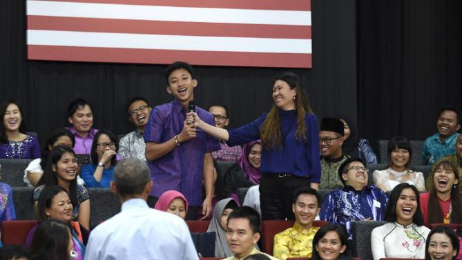 "President Barack Obama listens as he was called ""old"" as he was asked a question, by the man center in purple, during the Young Southeast Asian Leaders Initiative (YSEALI) town hall at Taylor's University in Kuala Lumpur, Malaysia, Friday, Nov. 20, 2015. (AP Photo/Susan Walsh)"