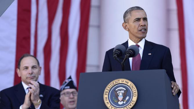 Veterans Affairs Secretary Robert McDonald applauds at left as President Barack Obama speaks at the Memorial Amphitheater of Arlington National Cemetery in Arlington, Va., Wednesday, Nov. 11, 2015, during Veterans Day ceremonies. (AP Photo/Susan Walsh)