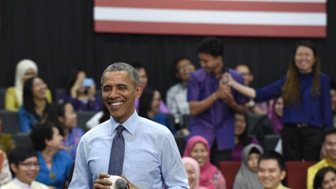 "President Barack Obama laughs as he was called ""old"" as he was asked a question, by the man center in purple, during the Young Southeast Asian Leaders Initiative (YSEALI) town hall at Taylor's University in Kuala Lumpur, Malaysia, Friday, Nov. 20, 2015. (AP Photo/Susan Walsh)"