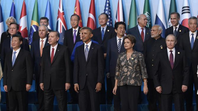 President Barack Obama, center, participates in a group photo with other leaders during the G20 Summit in Antalya, Turkey, Sunday, Nov. 15, 2015. Obama is attending the G20 Summit while on a nine-day foreign trip that also includes stops in the Philippines and Malaysia for other global security and economic summits. Joining Obama in the front row are, from left, China's President Xi Jinping, Turkey's President Recep Tayyip Erdogan, Brazil's President Dilma Rousseff, and Russia's President Vladimir Putin. (AP Photo/Susan Walsh)