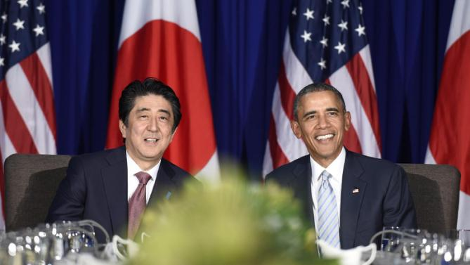 U.S. President Barack Obama, right, and Japan's Prime Minister Shinzo Abe, left, wait for the press to arrive during a bilateral meeting at the Asia-Pacific Economic Cooperation summit in Manila, Philippines, Thursday, Nov. 19, 2015. (AP Photo/Susan Walsh)