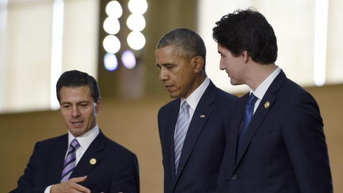 President Barack Obama, center, walks with Mexico's President Enrique Pena Nieto, left, Canada's Prime Minister Justin Trudeau, right, as they arrive for a group photo with leaders of the Asia-Pacific Economic Cooperation summit in Manila, Philippines, Thursday, Nov. 19, 2015. (AP Photo/Susan Walsh)