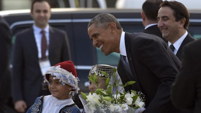 U.S. President Barack Obama is greeted by children as he arrives via Air Force One at Antalya International Airport in Antalya, Turkey, Thursday, Oct. 15, 2015. President Obama is on a nine-day trip to Turkey, the Philippines and Malaysia for global security and economic summits. (AP Photo/Susan Walsh)