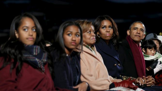 U.S. President Barack Obama and his family watch the National Christmas Tree Lighting and Pageant of Peace ceremony on the Ellipse Washington December 3, 2015. From left are daughters Maila and Sasha, Marian Robinson and first lady Michelle Obama. REUTERS/Kevin Lamarque