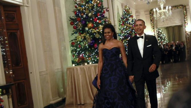 U.S. President Barack Obama and first lady Michelle Obama arrive at the Kennedy Center Honors Reception at the White House in Washington December 6, 2015. REUTERS/Yuri Gripas