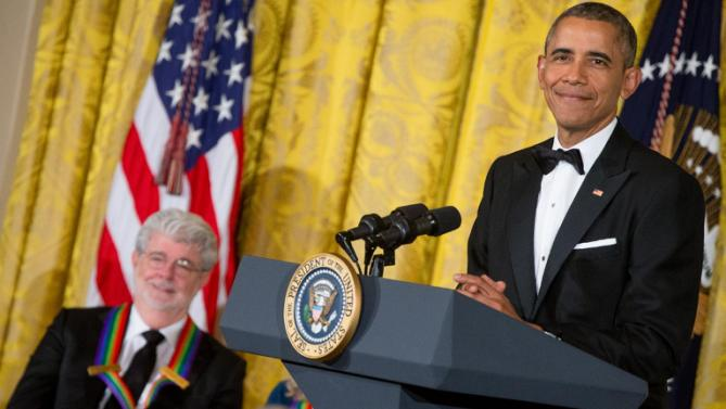 Filmmaker George Lucas, left, smiles as President Barack Obama pauses while speaking about him at the 2015 Kennedy Center Honors reception in the East Room of the White House in Washington, Sunday, Dec. 6, 2015, in Washington. The 2015 Kennedy Center Honors Honorees are singer-songwriter Carole King, filmmaker George Lucas, actress and singer Rita Moreno, conductor Seiji Ozawa, and actress Cicely Tyson. (AP Photo/Andrew Harnik)