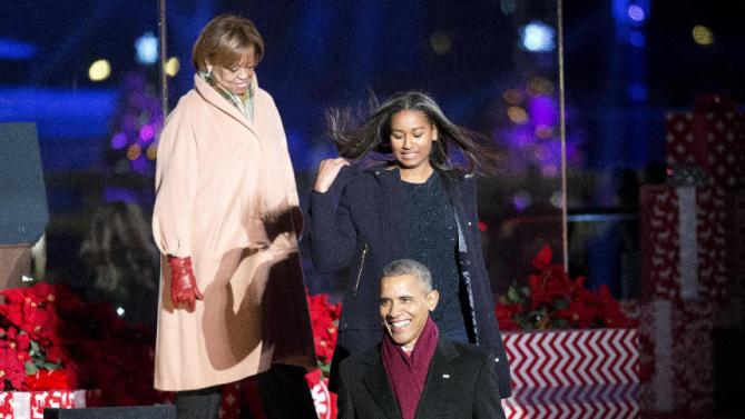 President Barack Obama, with daughter Sasha, and his mother-in-law Marian Robinson, walk to their seats during the National Christmas Tree Lighting ceremony at the Ellipse in Washington, Thursday, Dec. 3, 2015. (AP Photo/Pablo Martinez Monsivais)