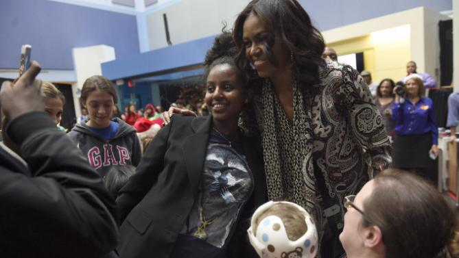 "First lady Michelle Obama poses for photos after reading ""Twas the Night Before Christmas"" to a group of children at the Children's National Health System in Washington, Monday, Dec. 14, 2015. Her appearance continued a first lady tradition that dates back more than 60 years to Bess Truman, who first brought holiday cheer to children not well enough to leave the hospital in time for Christmas. (AP Photo/Susan Walsh)"