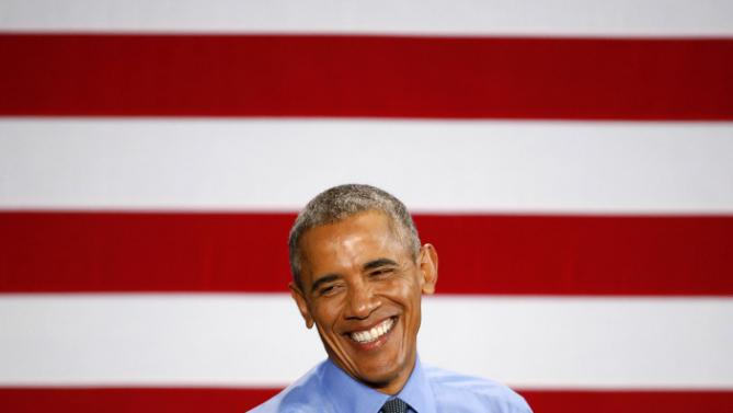 President Barack Obama smiles while speaking at the United Auto Workers-General Motors Center for Human Resources, Wednesday, Jan. 20, 2016 in Detroit. While in Detroit the president visited the 2016 North American International Auto Show and speak of the progress made by the city, its people and neighborhoods, and the American auto industry. (AP Photo/Paul Sancya)