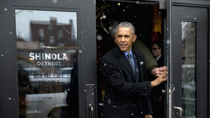 President Barack Obama leaves Shinola, a domestic manufacturer of watches and other goods after a tour, Wednesday, Jan. 20, 2016, in Detroit. While in Detroit the president is scheduled to visit the 2016 North American International Auto Show and speak of the progress made by the city, its people and neighborhoods, and the American auto industry. (AP Photo/Carolyn Kaster)