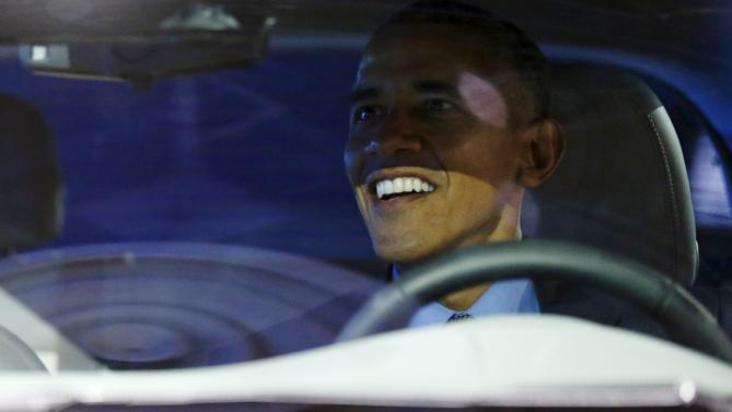 U.S. President Barack Obama smiles as he sits in an all-electric Chevrolet Bolt at the North American International Auto Show in Detroit, Michigan January 20, 2016. REUTERS/Jonathan Ernst