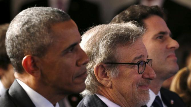 U.S. President Barack Obama, seated beside Steven Spielberg (C) and Israeli Ambassador to the U.S. Ron Dermer (R) listen to remarks at the Righteous Among the Nations Award Ceremony, organised for the first time in the U.S. by Yad Vashem, at the Embassy of Israel in Washington January 27, 2016. REUTERS/Kevin Lamarque