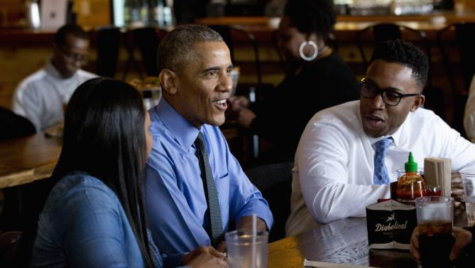 President Barack Obama has lunch with Teana Dowdell, autoworker at the General Motors' Detroit-Hamtramck Assembly, left, and Dr. Tolulope Sonuyi, Emergency medicine physician engaged with Detroit youth through violence prevention and intervention programs, part of Detroit's efforts around the My Brother's Keeper initiative, right, Wednesday, Jan. 20, 2016, at the Jolly Pumpkin Brewery in Detroit. While in Detroit the president is scheduled to visit the 2016 North American International Auto Show and speak of the progress made by the city, its people and neighborhoods, and the American auto industry. (AP Photo/Carolyn Kaster)