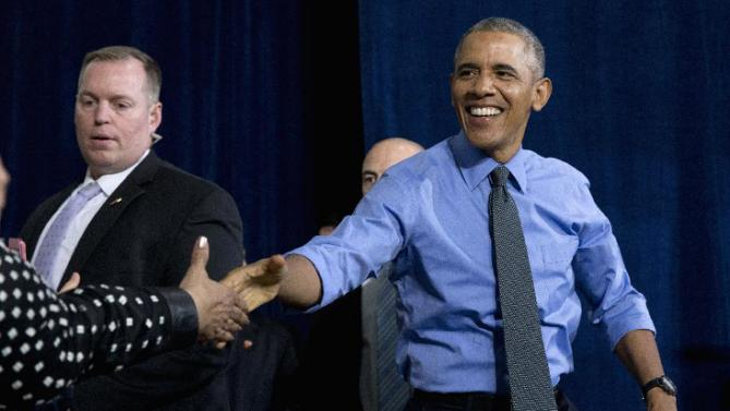 President Barack Obama shakes hands as he arrives to speak at the UAW-GM Center for Human Resources in Detroit, Wednesday, Jan. 20, 2016, to highlight the progress made by the city, its people and neighborhoods, and the American auto industry. (AP Photo/Carolyn Kaster)