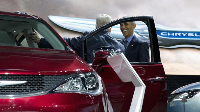 President Barack Obama stops at the Chrysler exhibit during visit to the 2016 North American International Auto Show in Detroit, Wednesday, Jan. 20, 2016, to highlight the progress made by the American auto industry. (AP Photo/Carolyn Kaster)