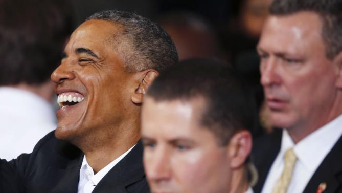 President Barack Obama laughs as he greets guests after speaking at a town hall styled event at McKinley Senior High School in Baton Rouge, La., Thursday, Jan. 14, 2016. (AP Photo/Gerald Herbert)