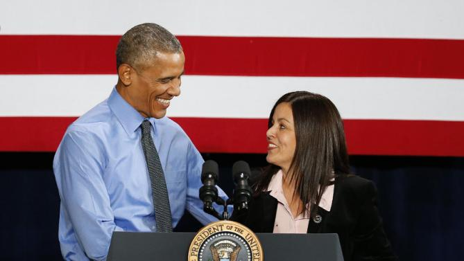 President Barack Obama is introduced by United Auto Workers Vice President Cindy Estrada at the UAW-General Motors Center for Human Resources, Wednesday, Jan. 20, 2016 in Detroit. While in Detroit the president is scheduled to visit the 2016 North American International Auto Show and speak of the progress made by the city, its people and neighborhoods, and the American auto industry. (AP Photo/Paul Sancya)