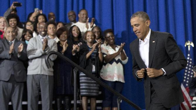 Attendees applauds as President Barack Obama arrives to speak during a town hall at McKinley Senior High School in Baton Rouge, La., Thursday, Jan. 14, 2016. After giving his State of the Union address, the president is traveling to tout progress and goals in his final year in office. (AP Photo/Carolyn Kaster)