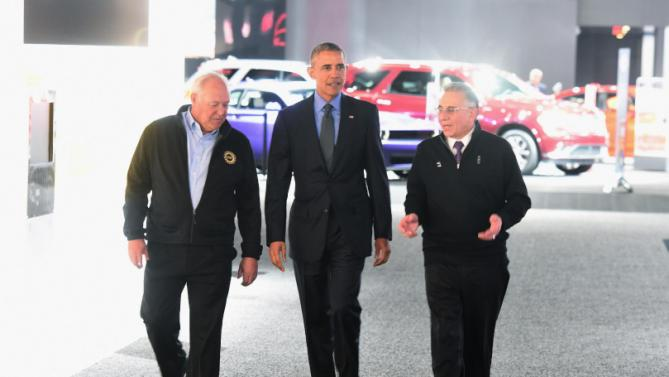 UAW President Dennis Williams, from left, President Barack Obama and North American International Auto Show (NAIAS) chairman Paul Sabatini talk during a tour of the NAIAS in Detroit, Wednesday, Jan. 20, 2016. (Daniel Mears/Detroit News via AP, Pool)