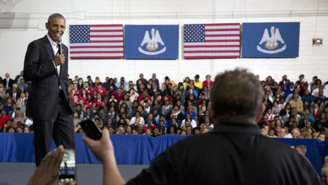 President Barack Obama takes a question from a man in the audience during a town hall at McKinley Senior High School in Baton Rouge, La., Thursday, Jan. 14, 2016. After giving his State of the Union address, the president is traveling to tout progress and goals in his final year in office. (AP Photo/Carolyn Kaster)