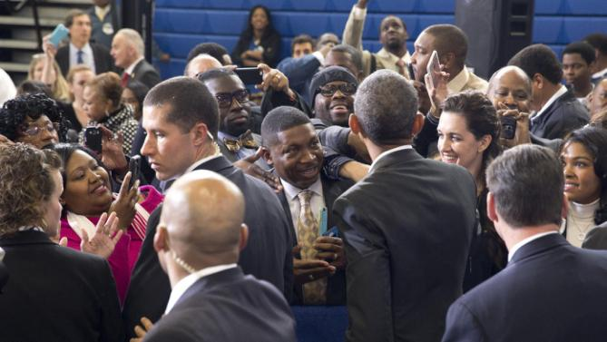 President Barack Obama greets people in the audience after speaking during a town hall at McKinley Senior High School in Baton Rouge, La., Thursday, Jan. 14, 2016. After giving his State of the Union address, the president is traveling to tout progress and goals in his final year in office. (AP Photo/Carolyn Kaster)