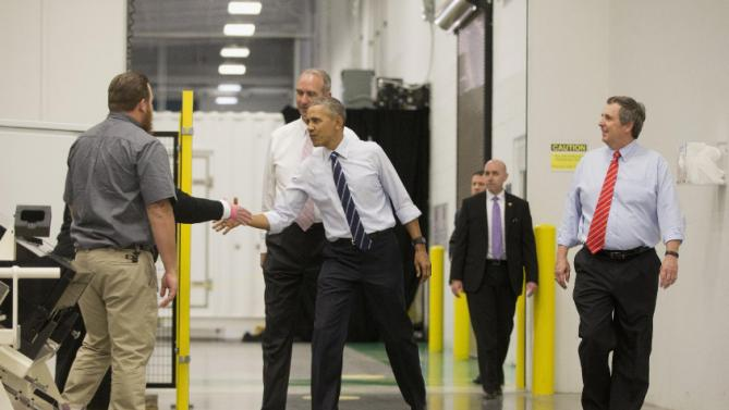 President Barack Obama greets employees during his tour of Saft America factory in Jacksonville, Fla., Friday, Feb. 26, 2016. Walking with Obama are Thomas Alcide, right, Saft America President and Chris Kaniut, behind Obama, Saft America General Manager. The plant opened in 2011 with help from federal money from economic stimulus package Obama pushed through Congress in 2009. (AP Photo/Pablo Martinez Monsivais)