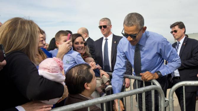 President Barack Obama greets guests on the tarmac by before boarding Air Force One at Moffett Federal Airfield in Mountain View, Calif., Thursday, Feb. 11, 2016. Obama is traveling Los Angeles to tape an appearance on the Ellen DeGeneres Show and attend a pair of private Democratice fundraisers later today. (AP Photo/Pablo Martinez Monsivais)