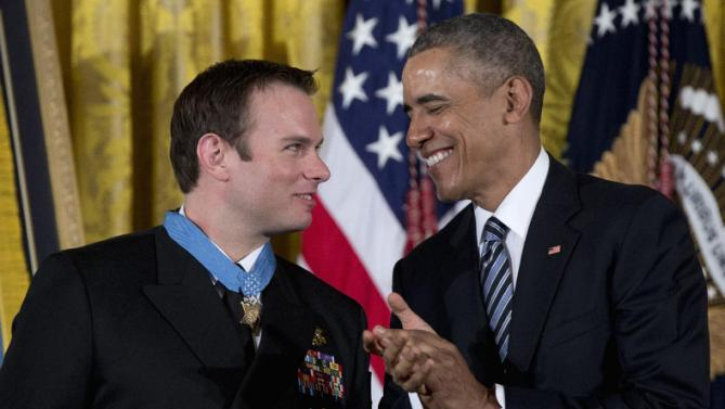President Barack Obama applauds after presenting the Medal of Honor to Senior Chief Special Warfare Operator Edward Byers during a ceremony in the East Room of the White House in Washington, Monday, Feb. 29, 2016. U.S. Navy. Senior Chief Byers received the Medal of Honor for his courageous actions while serving as part of a team that rescued an American civilian being held hostage in Afghanistan on December 8-9, 2012. (AP Photo/Carolyn Kaster)