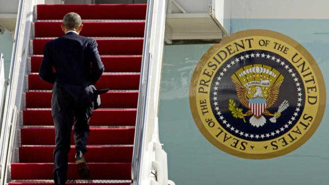 President Barack Obama climbs the stairs of Air Force One before his departure from Andrews Air Force Base, Md., Friday, Feb. 26, 2016, en route to Jacksonville, Fla., to visit Saft America factory, which opened in 2011 with help from federal money from economic stimulus package he pushed through Congress in 2009.( AP Photo/Jose Luis Magana)